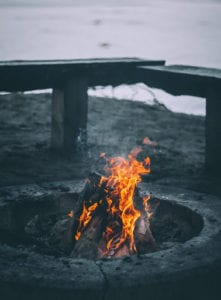 An outdoor fire pit made of stone
